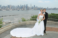 just married couple by the hudson with manhattan skyline in background